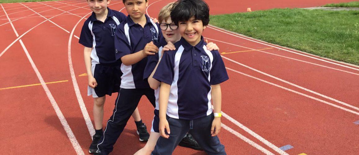 4 school boys on the athletics track